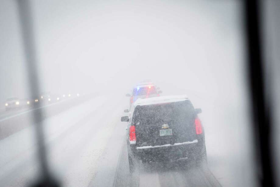 The motorcade of Democratic presidential candidate Sen. Bernie Sanders, I-Vt., drives through a snow storm on Interstate 93, Friday, Feb. 5, 2016, in Manchester, N.H. What started off as rain Friday morning quickly turned to sticky, heavy snow. Many school districts in the region closed for the day, including in some in Massachusetts, New Hampshire and Rhode Island. Photo: John Minchillo, AP / AP