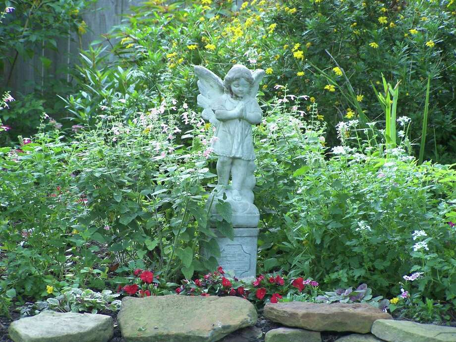 An angel statue watches over the backyard of Amy Backlas in Houston near the energy corridor. Her yard is is wildlife certified and draws lots of birds, bees, butterflies and other pollinators. Photo: Amy Backlas