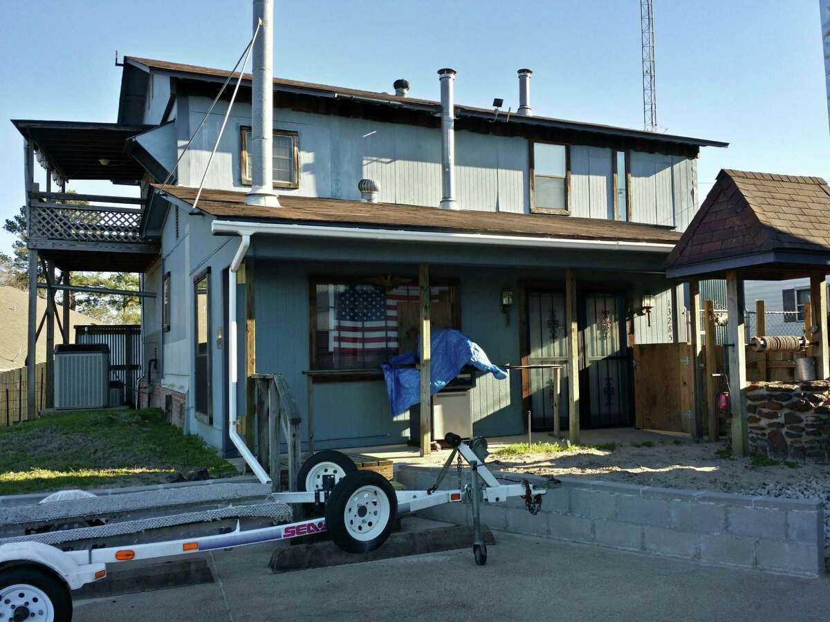 Wayne Fisher, of Tyler, has turned his single-wide mobile home into a large tin