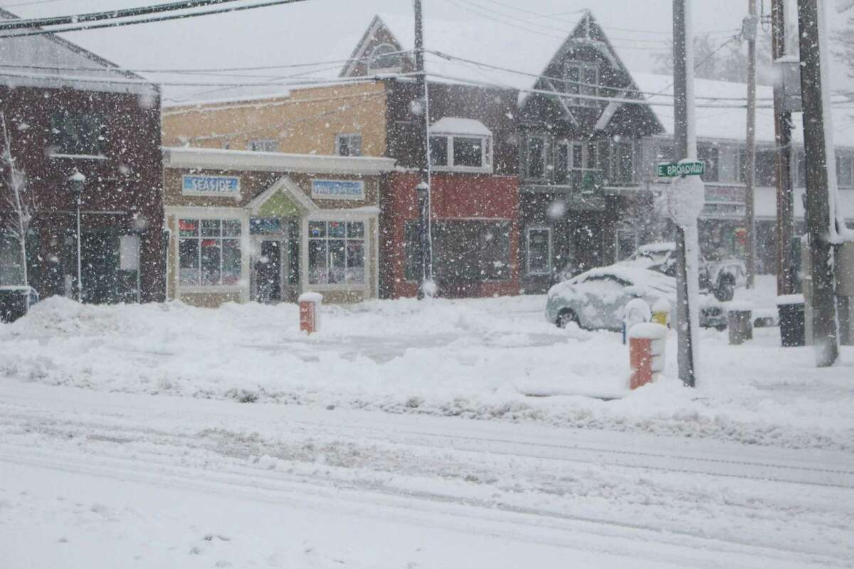 Snow fell steadily throughout the Milford area Friday morning.
