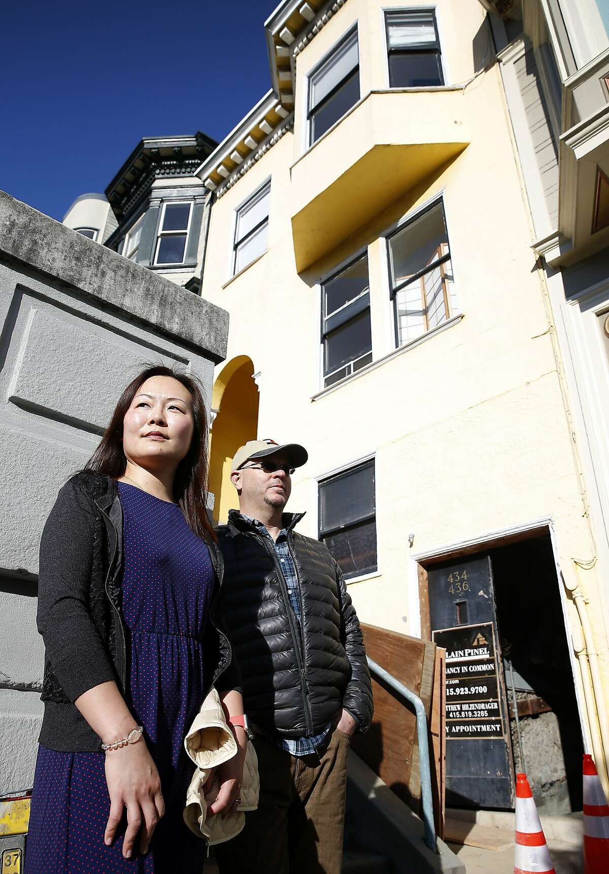 Michelle Huang and Tom Payne stop in front of the building on Vallejo Street where they own three TIC units in San Francisco, Calif. on Thursday, Feb. 4, 2016. They are embroiled in a feud with the owner of one of the other units who rented one of theirs through Airbnb and is now claiming residency asserting tenants rights.