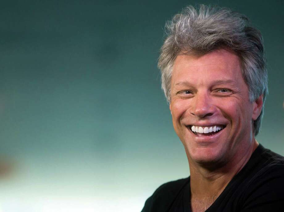 Musician Jon Bon Jovi laughs during media interviews in Vancouver, British Columbia, Saturday, Aug. 22, 2015. The singer is scheduled to play Rogers Arena Saturday night with Kings of Suburbia after their performance at Stanley Park was canceled. The City of Vancouver said earlier this week that the promoter, Paper Rain, didn't have the required permits for the group to perform at the park. (Darryl Dyck/The Canadian Press via AP)  ORG XMIT: VCRD101 Photo: DARRYL DYCK / CP