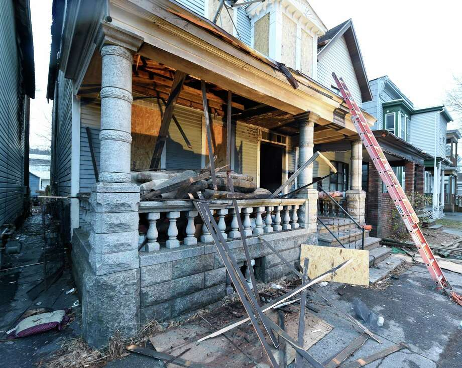 The heavily fire damaged home at 174 5th Avenue was being boarded up early Friday morning Feb. 5, 2016, in downtown Troy, N.Y.    (Skip Dickstein/Times Union) Photo: SKIP DICKSTEIN