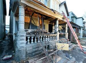 The heavily fire damaged home at 174 5th Avenue was being boarded up early Friday morning Feb. 5, 2016, in downtown Troy, N.Y.    (Skip Dickstein/Times Union)