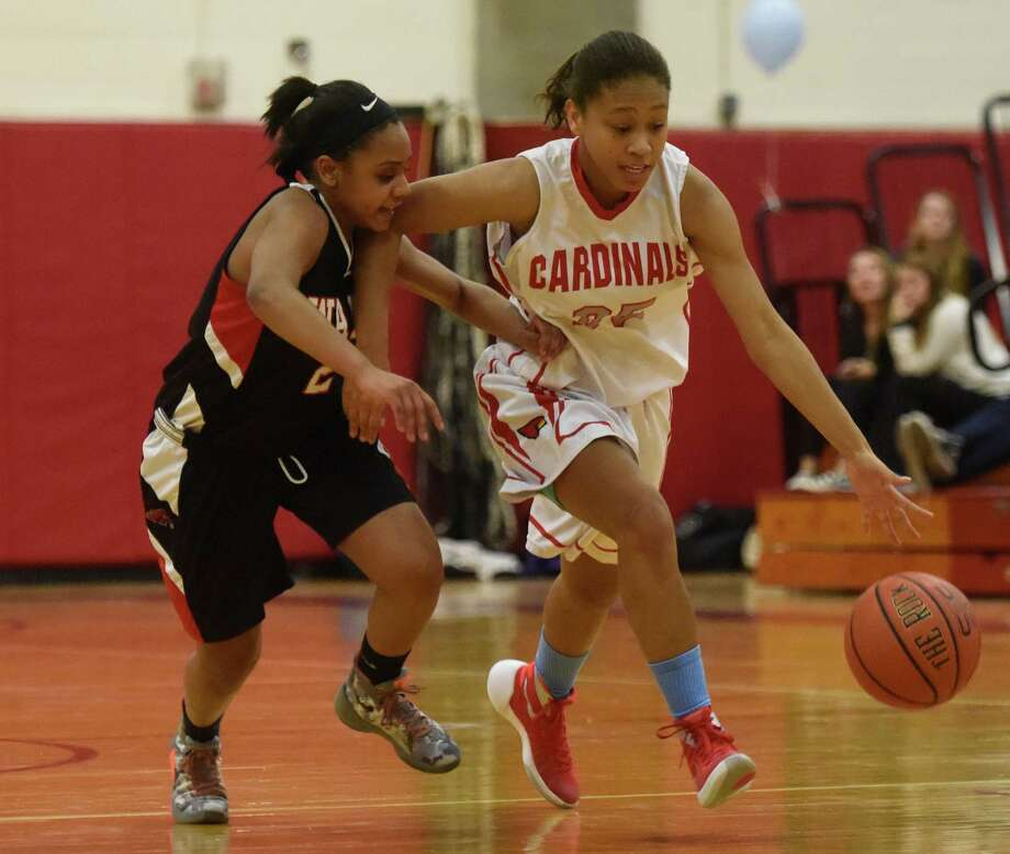 Fairfield Warde's Daja Polk (2) defends a Greenwich player during action Monday night. The Mustangs held on for a 50-47 win to remain undefeated in FCIAC play. Photo: Tyler Sizemore / Hearst Connecticut Media / Greenwich Time
