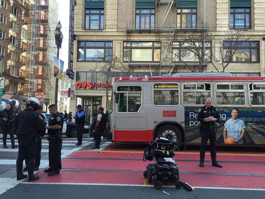 A person in motorized wheelchair was injured Friday morning when struck by a car on Market Street at Seventh Street in San Francisco. Photo: Kimberly Veklerov