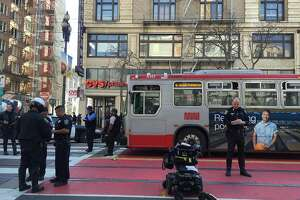 S.F. city vehicle hits woman in wheelchair on Market Street - Photo