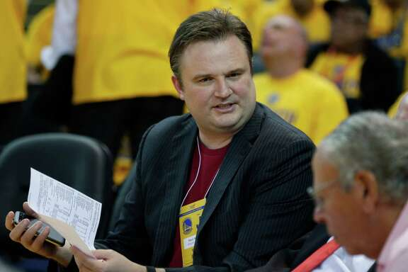 Houston Rockets general manager Daryl Morey sits on the sidelines during the third quarter of Game 2 of the NBA Western Conference Finals against the Golden State Warriors at Oracle Arena on Thursday, May 21, 2015, in Oakland.  ( James Nielsen / Houston Chronicle )