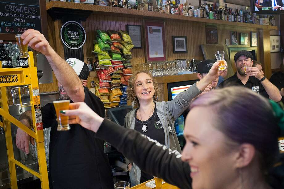 Manager Keti Batti and employees toast prior to the unveiling of the Pliny The Younger beer at the Russian River Brewing Company in Santa Rosa, Calif. on Friday, Feb. 5, 2016 Photo: Chris Preovolos/SFGate