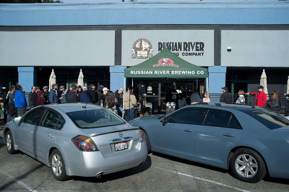 Customers line up for blocks during the unveiling of the Pliny The Younger beer at the Russian River Brewing Company in Santa Rosa, Calif. on Friday, Feb. 5, 2016