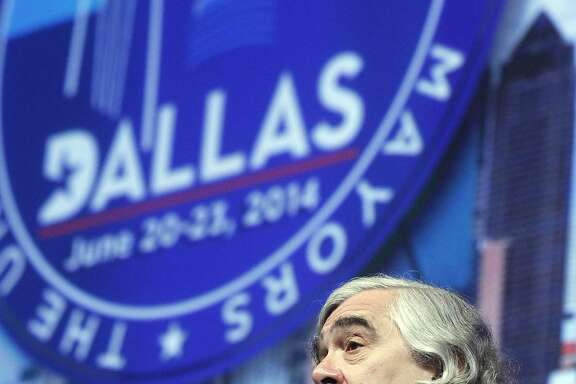 "Ernest Moniz, secretary, United States Dept. of Energy, discusses climate protection at the U.S. Conference of Mayors in Dallas, on Sunday, June 22, 2014. Attendees of the U.S. Conference of Mayors voted Sunday to sign the U.S. Mayors Climate Protection Agreement in Dallas, on Sunday, June 22, 2014. The resolution encourages cities to use natural solutions to ""protect freshwater supplies, defend the nation's coastlines, maintain a healthy tree cover and protect air quality,"" sometimes by partnering with nonprofit organizations. The resolution only ""encourages"" steps rather than mandating action. (AP Photo/The Dallas Morning News, Michael Ainsworth) MANDATORY CREDIT; MAGS OUT; TV OUT; INTERNET USE BY AP MEMBERS ONLY; NO SALES"