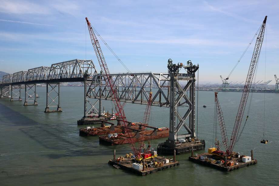 The first of the 504 foot trusses (middle) of the San Francisco Bay bridge first erected in 1935 is about to be placed on barges in Oakland, California, on Friday,  February 5, 2016.  Each truss is approximately 950 lbs. to 1 million pounds. Photo: Liz Hafalia, The Chronicle