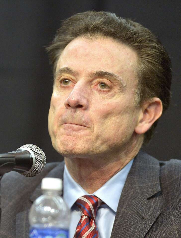 Louisville head basketball coach Rick Pitino reacts to a question from the media following the University's announcement that they will be self-imposing a ban on postseason play for the 2015-16 season, Friday, Feb. 5, 2016, in Louisville Ky. Louisville announced a one-year postseason ban for its men's basketball team amid ongoing investigations into a sex scandal in which an escort alleged that a former staffer paid her and other dancers to strip and have sex with recruits and players. (AP Photo/Timothy D. Easley)
