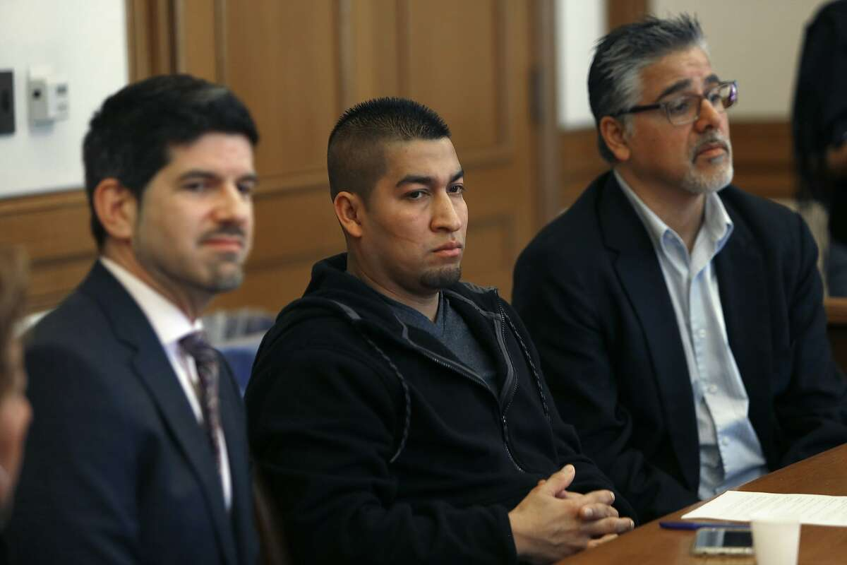 Immigration attorney Zachary Nightingale (left), Mission district resident Pedro Figueroa-Zarceno (middle) and supervisor John Avalos (right) talk during a press conference concerning Pedro's immigration detention in city hall in San Francisco, California, on Friday, February 5, 2016.