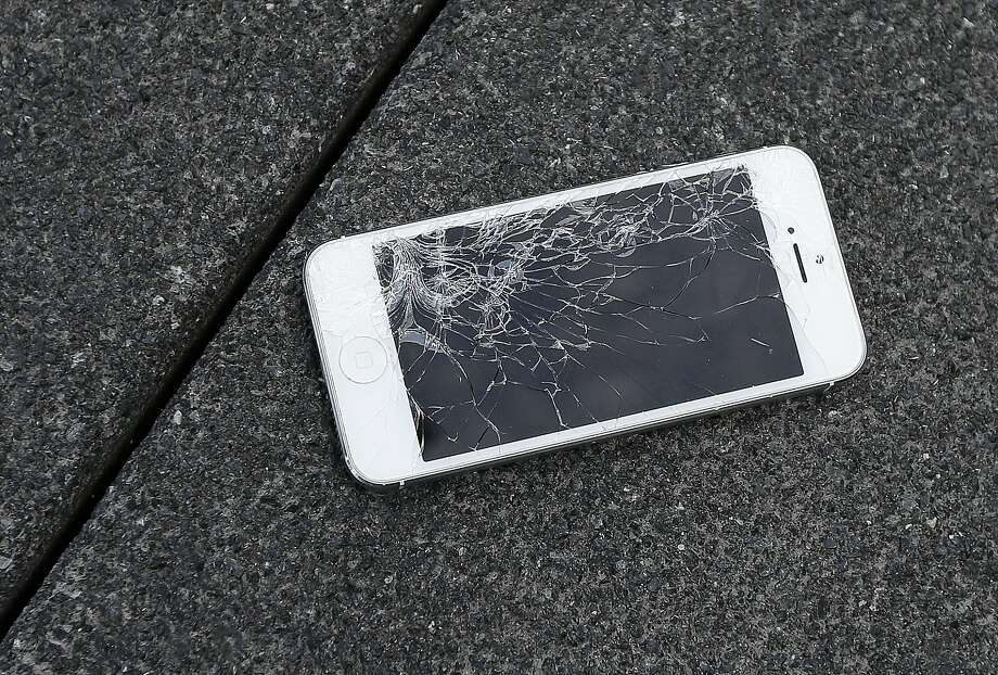 Apple will now accept iPhones that have cracked screens or other damage for credit on a new one. Photo: Ben Margot, Associated Press