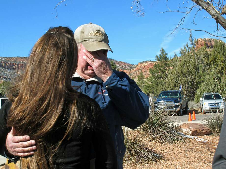 "Ben Tenney, a Kanab, Utah, resident, gives his condolences to the daughter of Arizona rancher Robert ""LaVoy"" Finicum outside the church where services were held. Photo: Felicia Fonseca, Associated Press"