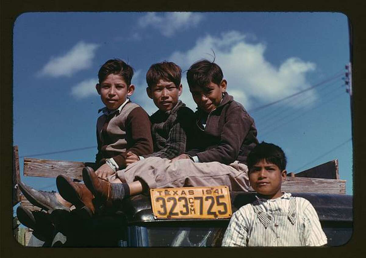 A 1942 photo by Arthur Rothstein shows boys sitting on a truck parked at a labor camp in Robstown, Texas. Source: Library of Congress