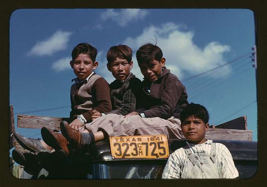 A 1942 photo by   Arthur Rothstein shows boys sitting on a truck parked at a labor camp in Robstown, Texas. 