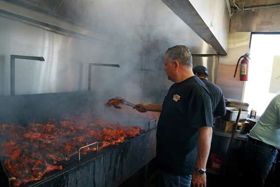 Owner Frank Garcia grills chicken were the smoke was one of the problems. There were long lines as Pollos Asados Los Norteños reopened Friday after it was closed due to violations of city code. It had raised concerns among neighbors who said the uncontrolled smoke caused health and safety hazards on Friday, February 5, 2016