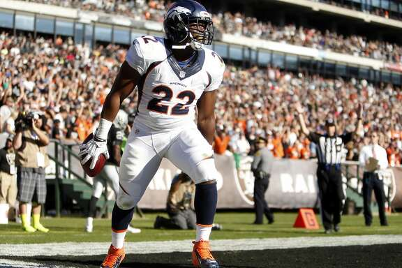 Denver Broncos' C.J. Anderson celebrates his 51-yard pass reception for a touchdown in 2nd quarter against Oakland Raiders during NFL game at O.co Coliseum in Oakland, Calif., on Sunday, November 9, 2014.