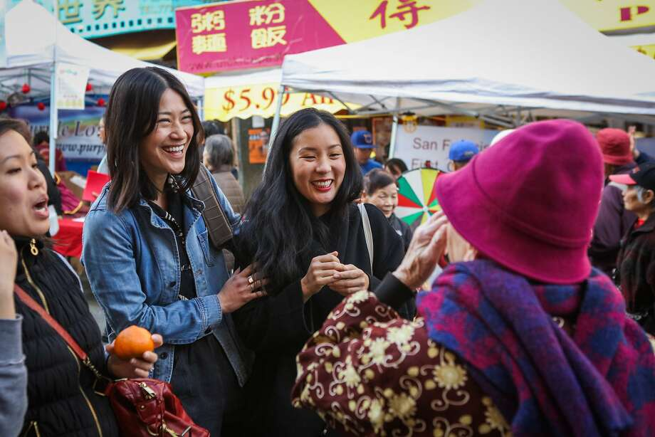 "Andria Lo (second from left) and Valerie Luu (second from left) talk to a potential subject for their ""Chinatown Pretty"" project, in San Francisco, California on Saturday, January 30, 2016. Artists Andria Lo and Valerie Luu have been photographing fashionable seniors in Chinatown. Photo: Gabrielle Lurie, Special To The Chronicle"