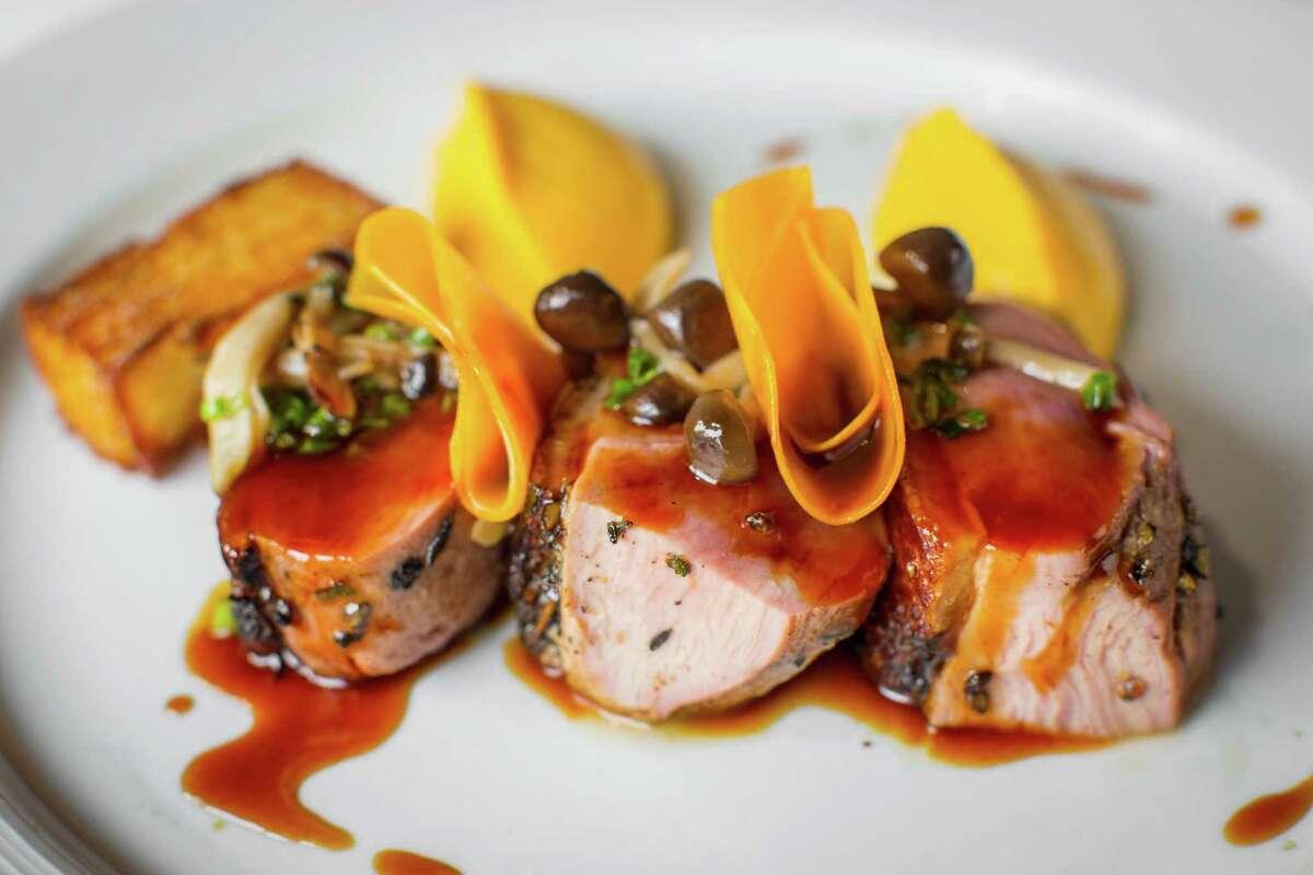 Magret de canard a l'orange (roasted duck breast with butternut squash mousseline, crispy potato cake and beech mushrooms)Etoile Cuisine et Bar