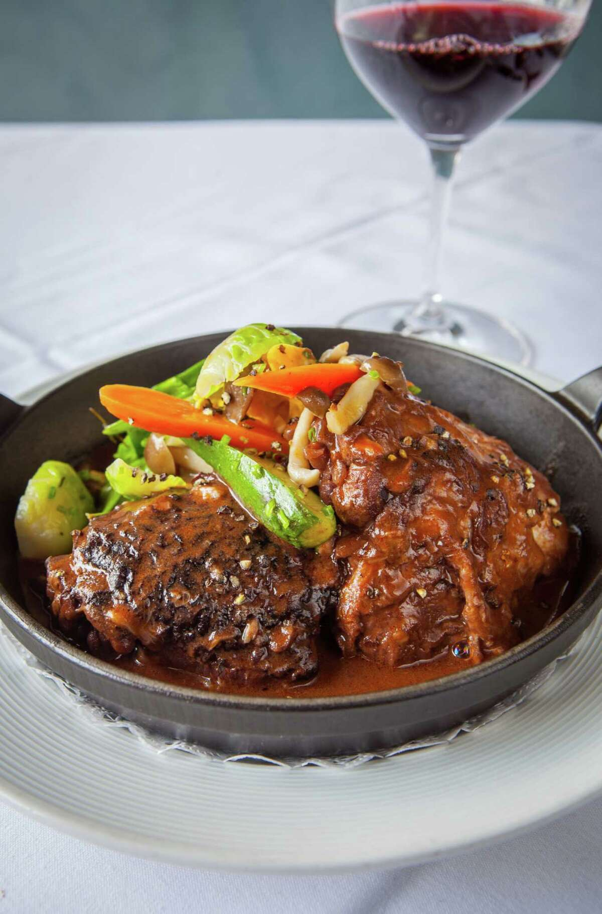 Etoile Cuisine et Bar: Coq au Vin, chicken braised in red wine with creamy potatoes and spring vegetables. Etoile's coq au vin, chicken braised in red wine, creamy potatoes, spring vegetables.