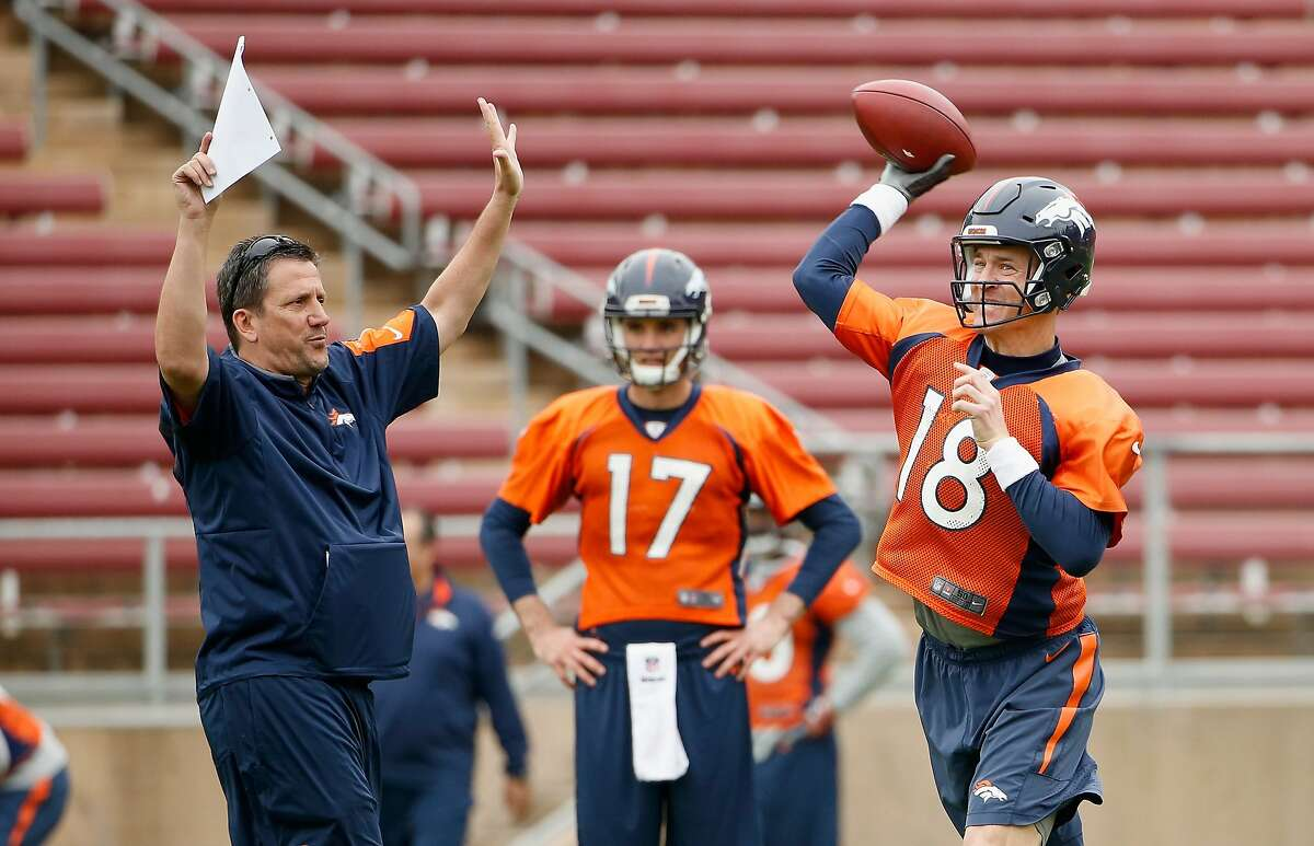 STANFORD, CA - FEBRUARY 03: Brock Osweiler #17 watches Peyton Manning #18 of the Denver Broncos work with quarterback coach Greg Knapp during the Broncos practice for Super Bowl 50 at Stanford University on February 3, 2016 in Stanford, California. The Broncos will play the Carolina Panthers in Super Bowl 50 on February 7, 2016. (Photo by Ezra Shaw/Getty Images)
