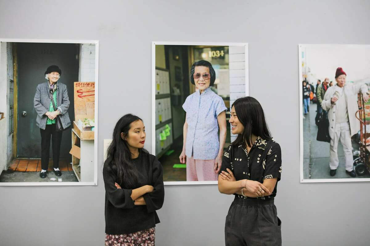 """Artists Valerie Luu and Andria Lo discuss their photography project """"Chinatown Pretty"""" among their photographs at gallery space 41 Ross Alley, in San Francisco, California on Saturday, January 30, 2016. For their project, they have been photographing fashionable seniors in Chinatown."""