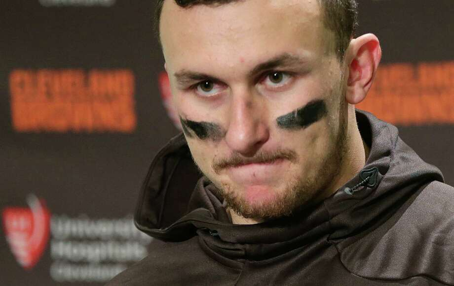 In this Sunday, Dec. 20, 2015, file photo, Cleveland Browns quarterback Johnny Manziel speaks with media members after an NFL football game against the Seattle Seahawks, in Seattle. Photo: Scott Eklund /Associated Press / FR171040 AP