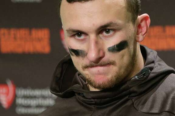 In this Sunday, Dec. 20, 2015, file photo, Cleveland Browns quarterback Johnny Manziel speaks with media members after an NFL football game against the Seattle Seahawks, in Seattle.