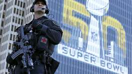 San Francisco Police tactical unit officer Jeff McHale watches the crowd at Super Bowl City Tuesday, Feb. 2, 2016 in San Francisco. From ticket scalpers to terrorism, football's biggest game always presents challenges large and small for law enforcement officials. Their task is made more difficult by the location of Super Bowl 50, some 45 miles from downtown San Francisco, and a number of events throughout the sprawling Bay Area in the run up to the game in Santa Clara on Sunday. (AP Photo/Charlie Riedel)