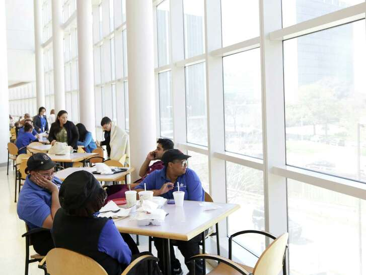 Jocasta Redman looks out the window as she eats lunch with two friends at Texas Children's Hospital Wednesday, Feb. 3, 2016, in Houston. An advocacy group, Physicians Committee for Responsible Medicine, seeks the removal of fast food restaurants from hospital cafeterias.  ( Jon Shapley / Houston Chronicle )