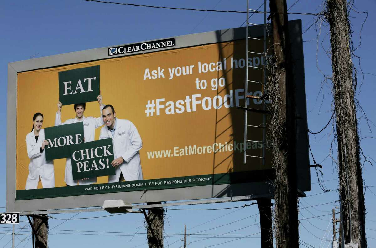 The Physicians Committee for Responsible Medicine paid for this billboard to advocates for the removal of fast-food restaurants from hospitals.