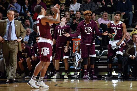 Head coach Billy Kennedy of the Texas A&M Aggies and his bench reacts during the final moments of the second half of a 77-60 Vanderbilt upset of Texas A&M at Memorial Gym on Feb. 4, 2016 in Nashville, Tennessee.