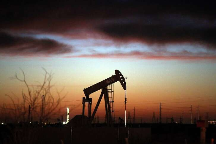 An oil pumpjack works at dawn in the Permian Basin oil field last month in the oil town of Andrews. Baker Hughes reported Friday that U.S. oil producers idled 48 drilling rigs this week, including 31 oil rigs.