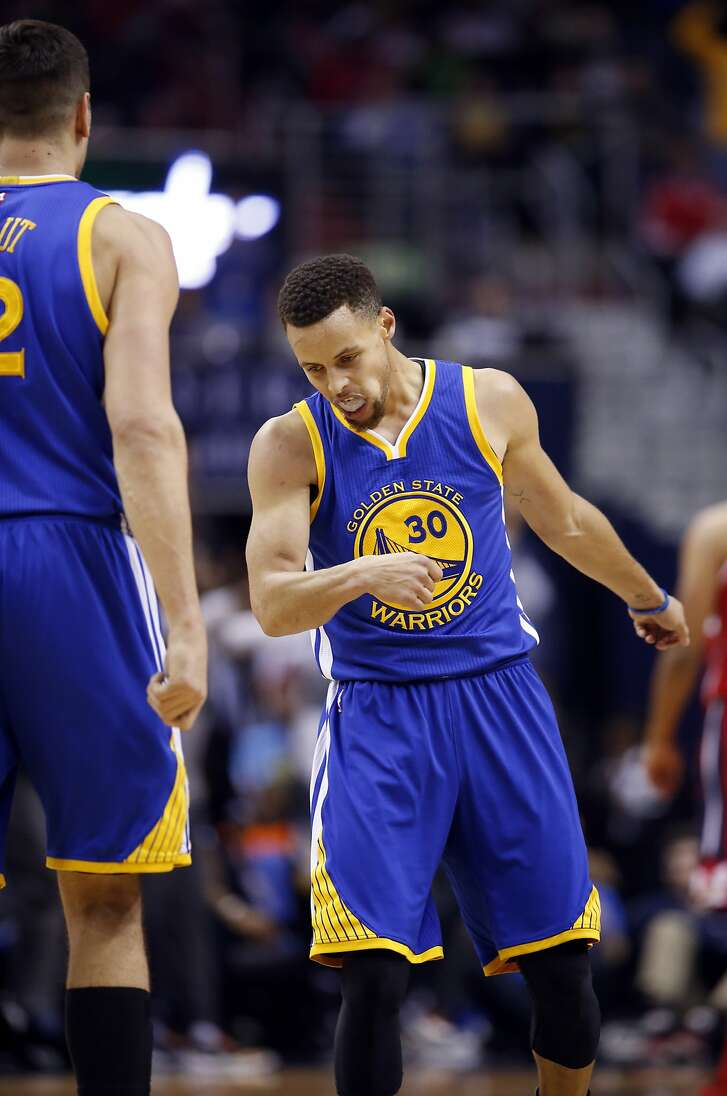 Golden State Warriors guard Stephen Curry (30) reacts in the first half of an NBA basketball game against the Washington Wizards, Wednesday, Feb. 3, 2016, in Washington. (AP Photo/Alex Brandon)