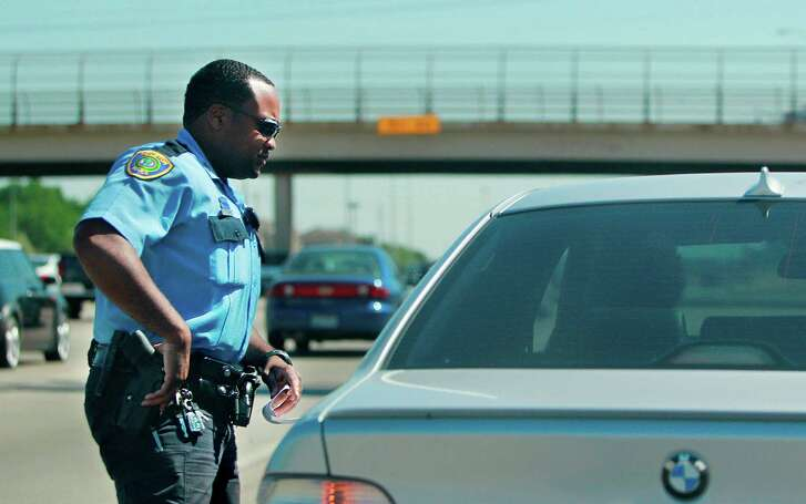 Houston Police Officer R.V. Smart approaches a vehicle to inquire about reason for speeding and drivers license along southbound on 288 during his patrol on Thursday, April 28, 2011, in Houston. ( Mayra Beltran / Houston Chronicle )
