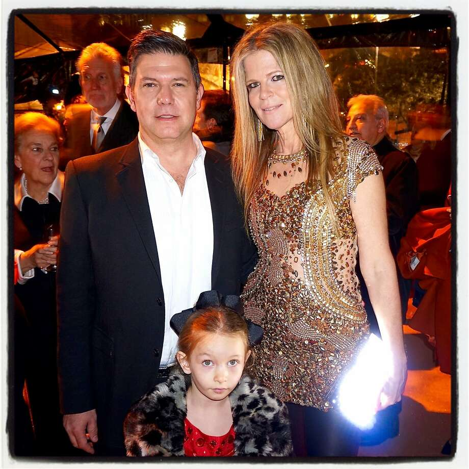 """""""Bay Lights"""" artist Leo Villareal with his wife, Yvonne Force (holding an LED Lisa Sperry clutch he collaborated on) and their daughter, Lux, at Waterbar for the SB50 kickoff starring a relaunch of his Bay Bridge public art work. Jan 2016. Photo: Catherine Bigelow, Special To The Chronicle"""