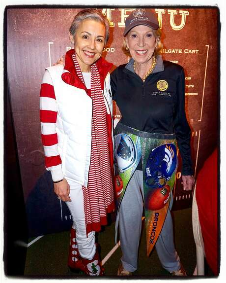 """SF Symphony President and proud Stanford alum Sako Fisher models """"tailgate chic"""" with Protocol Chief Charlotte Shultz, and SB50 Host Committee member, at the symphony's """"Concert of Champions."""" Jan 2016. Photo: Catherine Bigelow, Special To The Chronicle"""