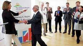 Suzie Feldmann, presiding chair of the Putting Children First Campaign and CEO of the Goldsbury Foundation, introduced Harvey Najim as the Children's Hospital of San Antonio unveiled the Harvey E. Najim Blood and Marrow Transplant Center on Friday.