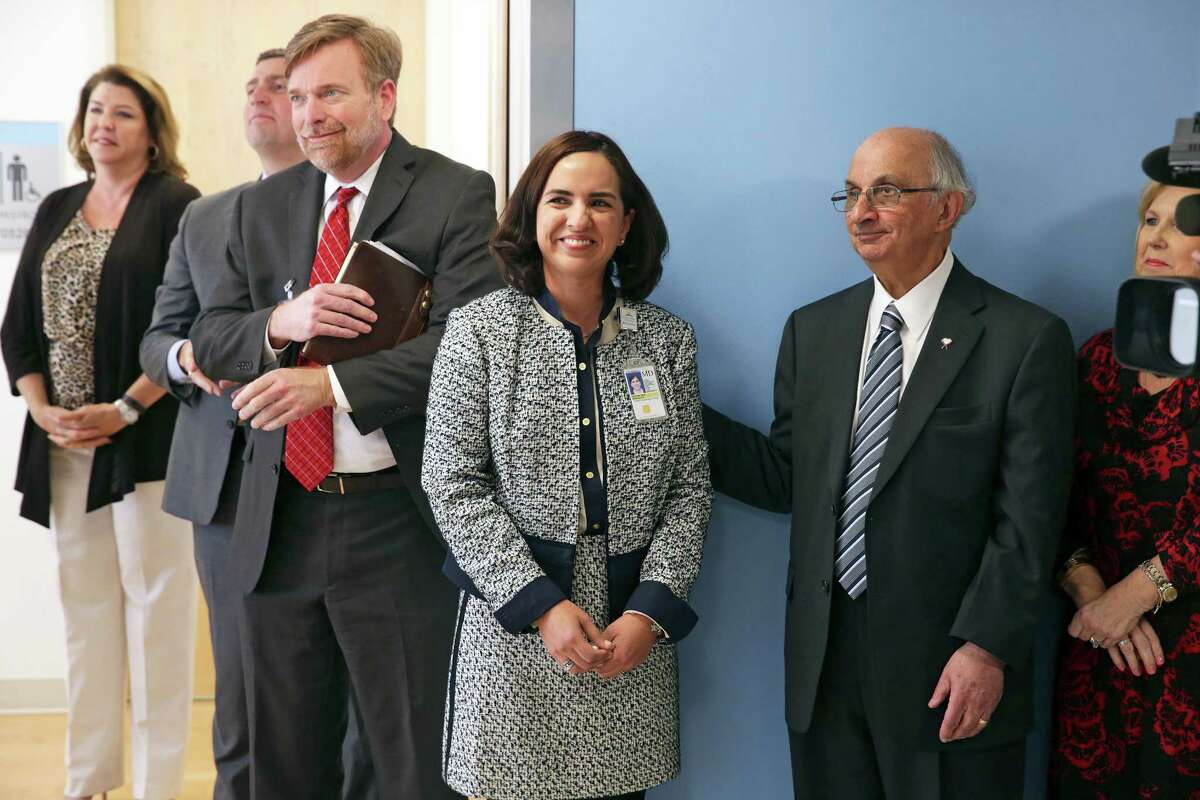 Harvey Najim, right, congratulated Dr. Veronica Jude as the Children's Hospital of San Antonio announced the creation of the Harvey E. Najim Blood and Marrow Transplant Center on Firday. Jude is medical director of the blood and marrow transplant center.