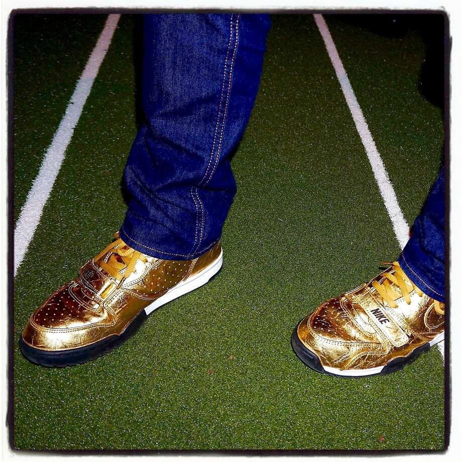 """SB50 Chairman Daniel Lurie sports his gold, limited-edition Nike kicks at the Symphony's """"tailgate chic"""" dinner before the """"Concert of Champions."""" Jan 2016. Photo: Catherine Bigelow, Special To The Chronicle"""