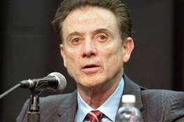 Louisville head basketball coach Rick Pitino listens to a question during a press conference, Friday, Feb. 5, 2016, in Louisville Ky. The University announced a one-year postseason ban for its men's basketball team amid ongoing investigations into a sex scandal in which an escort alleged that a former staffer paid her and other dancers to strip and have sex with recruits and players. (AP Photo/Timothy D. Easley) ORG XMIT: KYTE109