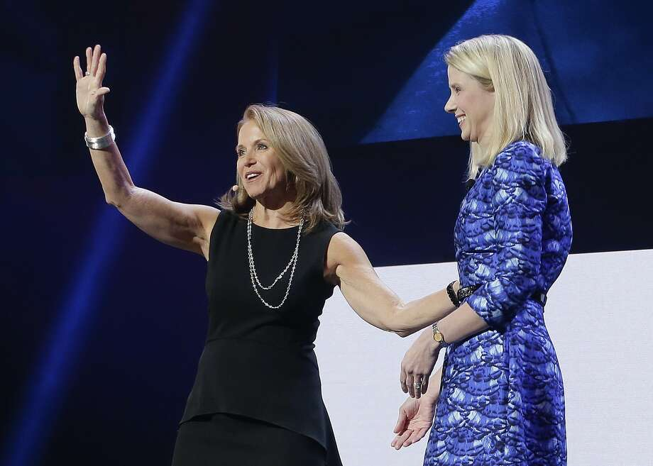 Former CBS News anchor Katie Couric waves to the audience next to Yahoo Yahoo president and CEO Marissa Mayer after speaking during a Yahoo presentation at the International Consumer Electronics Show, Tuesday, Jan. 7, 2014, in Las Vegas. (AP Photo/Julie Jacobson) Photo: Julie Jacobson, AP