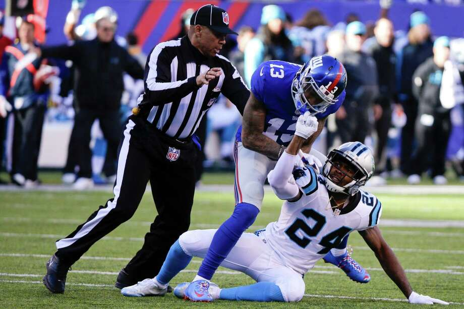A referee, left, separates New York Giants wide receiver Odell Beckham (13) and Carolina Panthers' Josh Norman (24) during the first half of an NFL football game Sunday, Dec. 20, 2015, in East Rutherford, N.J. (AP Photo/Julie Jacobson) ORG XMIT: ERU105 Photo: Julie Jacobson / AP