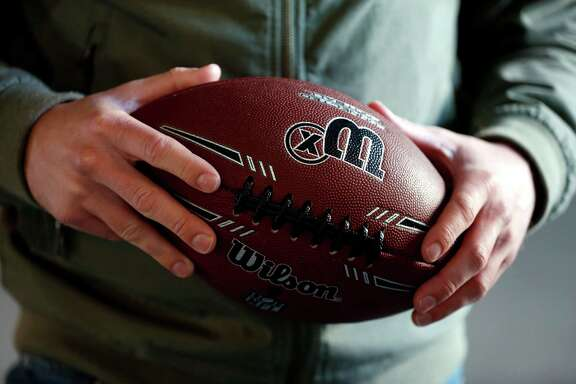 Eric Ansel holds a prototype design of the Wilson X Connected Football in San Francisco, California, on Tuesday, Feb. 2, 2016.