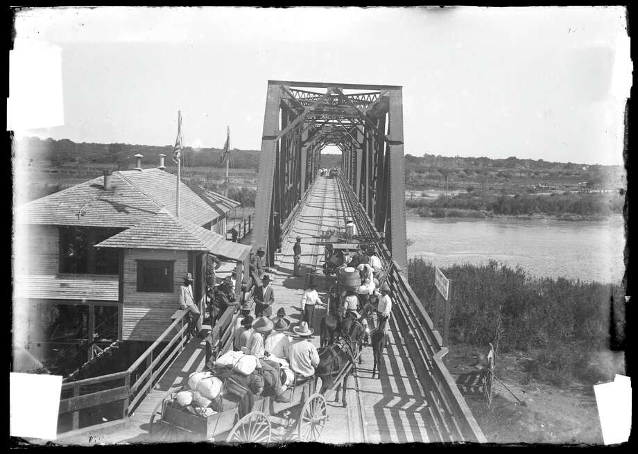 """This vintage picture of the International Bridge in Brownsville features in the Bullock Museum's new exhibit called """"Life & Death on the Border: 1910-1920.""""   Photo: Courtesy Robert Runyon Photograp / Courtesy Robert Runyon Photograp"""
