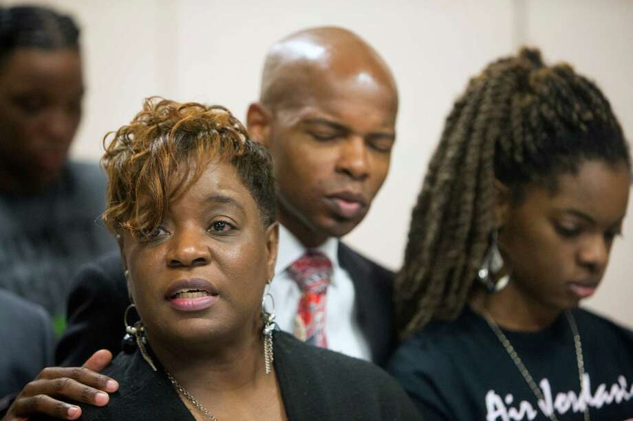 Relatives of Joshua Woods, including his mother, Dazie Williams, left, and sister, Joshlyn Woods, have asked Nike and Michael Jordan to change the sales approach of the popular Air Jordans basketball shoes. Community activist Deric Muhammad supported the family during the capital murder trial of Neal Bland. Photo: Cody Duty, Staff / © 2015 Houston Chronicle