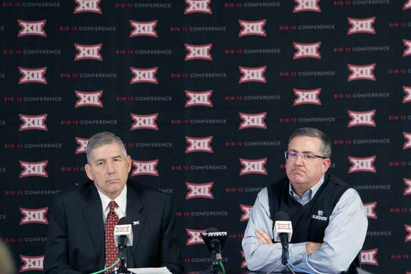 Big 12 commissioner Bob Bowlsby, left, and Kansas State president Kirk Schulz meet the media after the conference's presidents and chancellors met Friday.